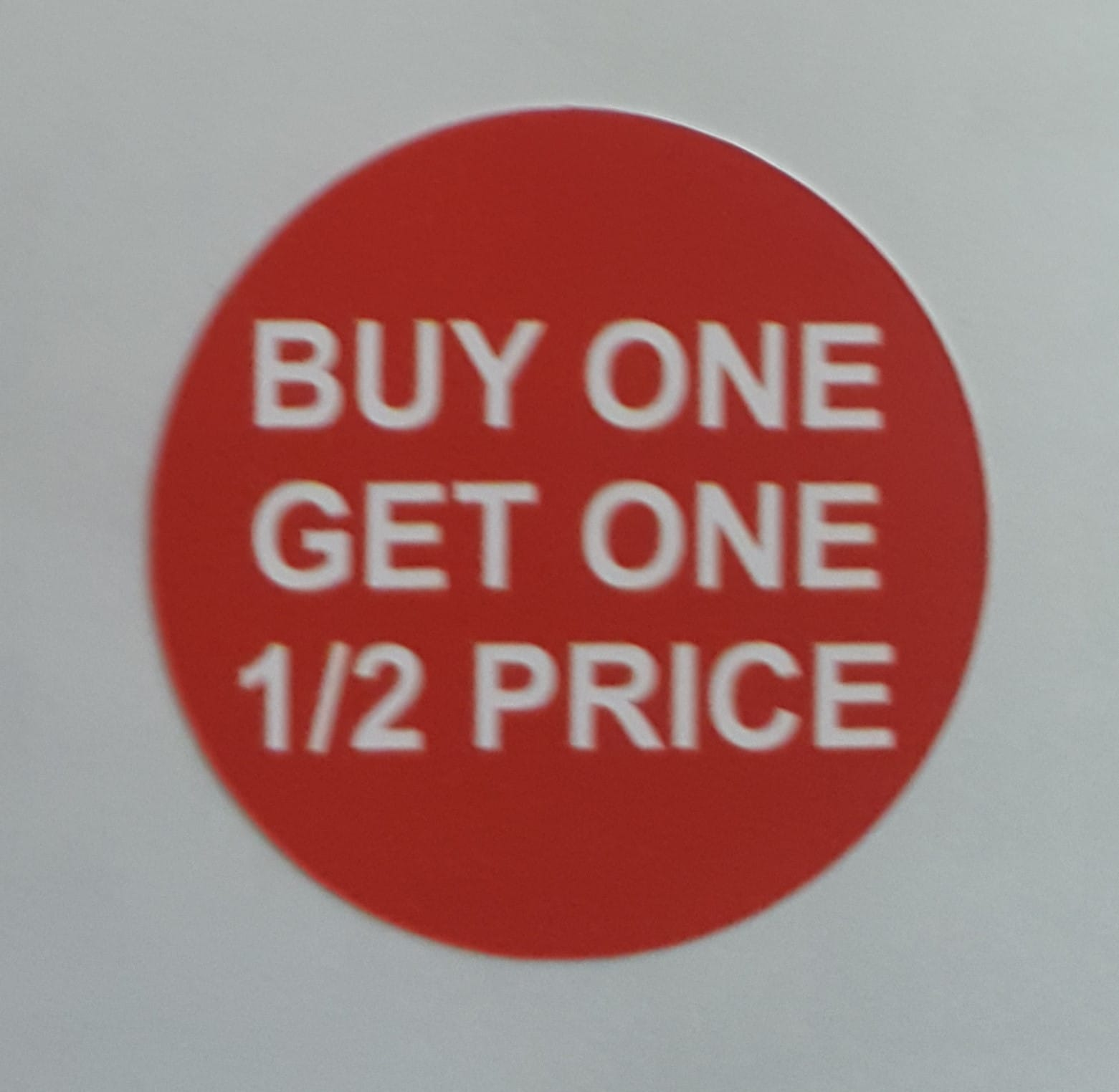 Buy 1 get 1 half price stickers